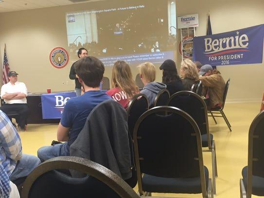 Area Bernie Sanders supporters listen as event organizer