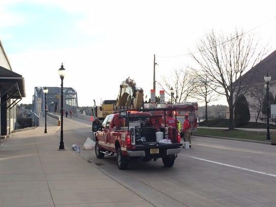 Emergency vehicles at the Michigan Street Bridge in