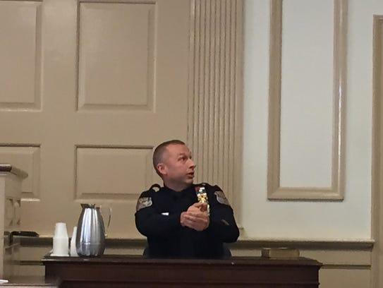 Mount Olive Detective Eric Krouse demonstrates how