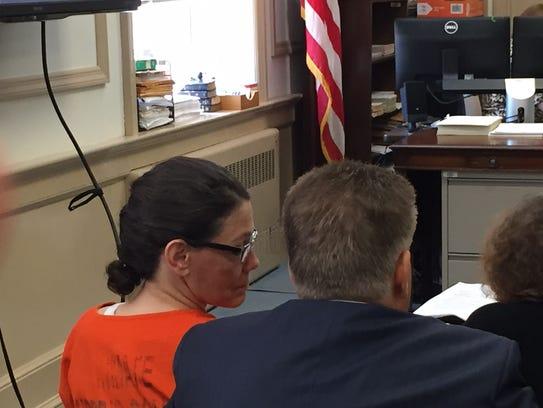 Accused killer Virginia Vertetis confers with defense