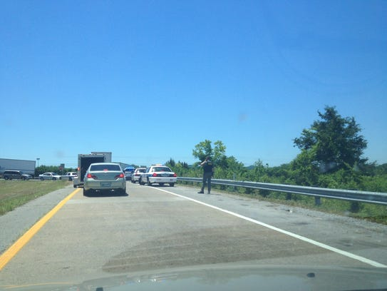 Law enforcement officers work the scene off I-24 near