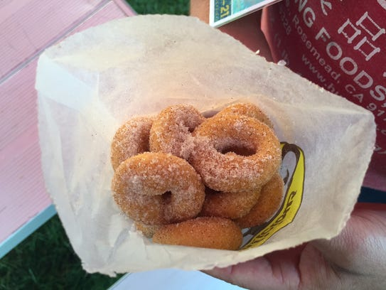 Cinnamon sugar coats these mini doughnuts from JR Mini