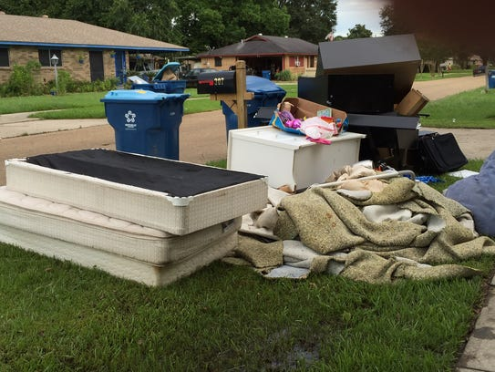 Residents of Knollwood Drive in Lafayette spent Sunday