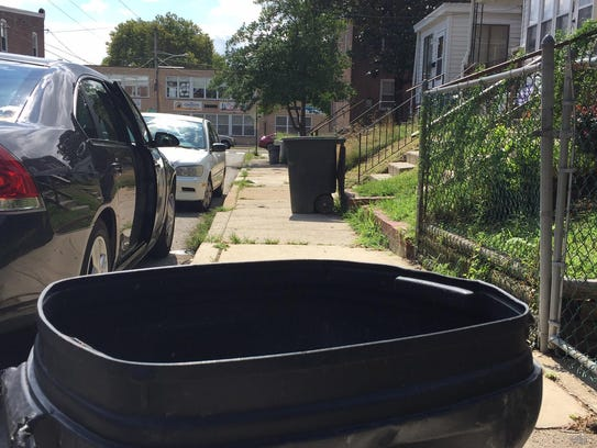 Garbage cans line the 800 block of East 22nd Street