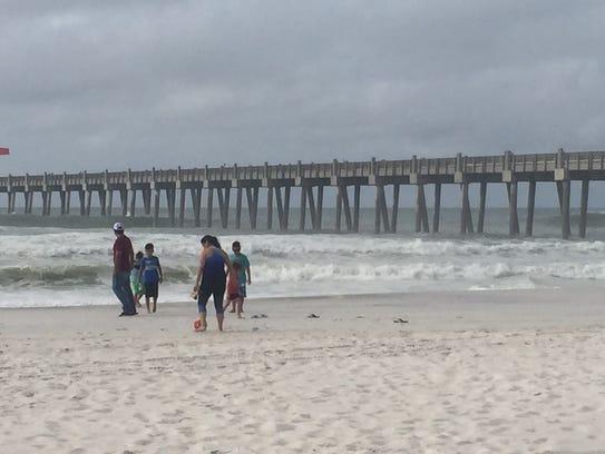 Waves crash along the shores of Pensacola Beach as