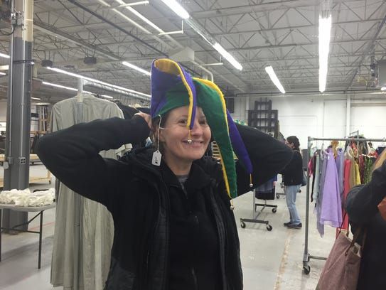 Lisa Cohen tries on a jester's hat at the Shakespeare