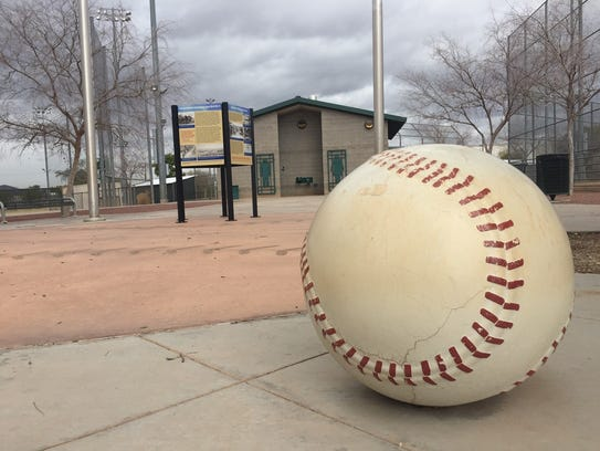 Nozomi Park's history kiosk stands between two baseball