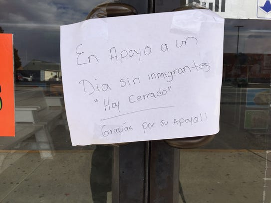 This sign was posted in a  storefront window Thursday