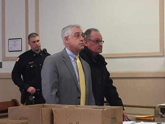 On far right, Robert J. Guidi, with defense lawyer