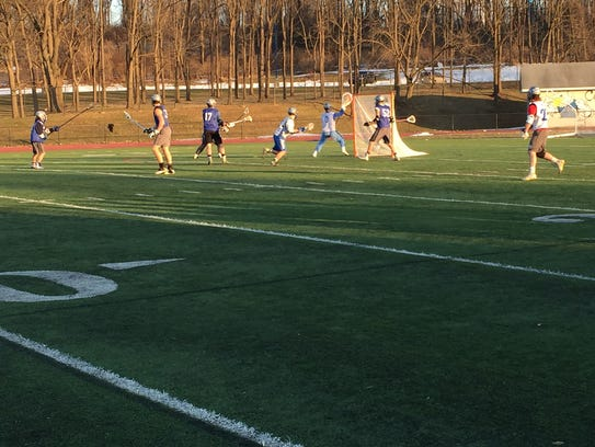 The Cedar Crest boys lacrosse team scrimmages during