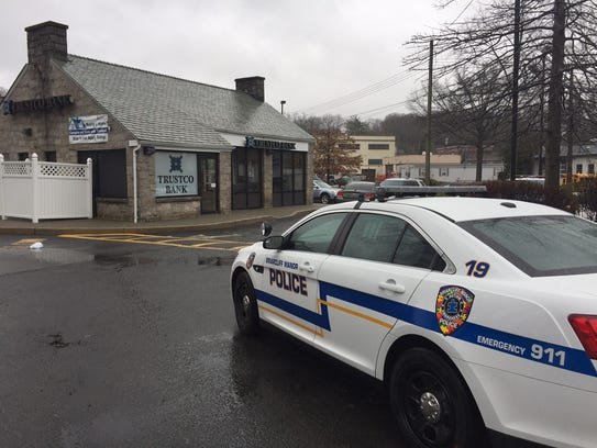 Police at the scene after the Trustco Bank at 75 N.