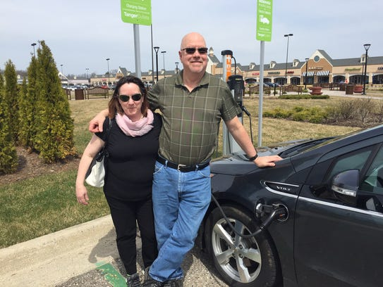 Sarah and Craig Middlebrook, of Jackson, use charging