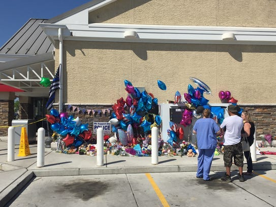 People pay their respects Friday to Delaware State