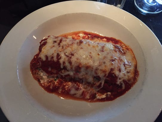 The lasagna ($16.95) at Simon's in Des Moines provides