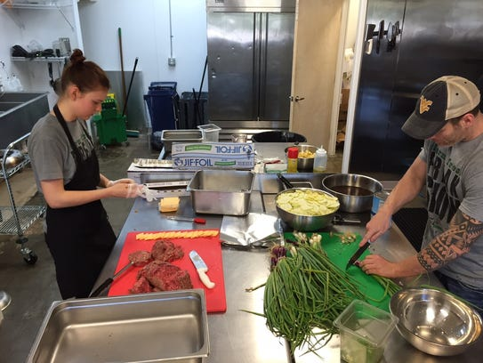 Executive chef Alexis Krueger preps food alongside