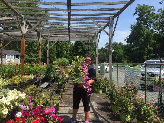 Customers made a final stop at Baker's Nursery in Monroe