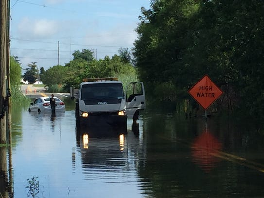 A car is stranded on Airport Road near  I-95 on Monday