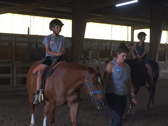Ethan Kaiser goes on a horse ride at St. Elizabeth's