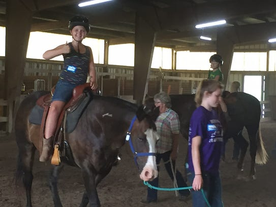 Talena Shadowens gives a thumbs up during her ride.