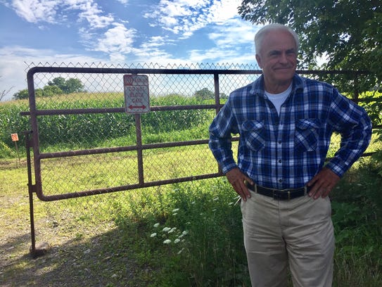 Roger Powers Sr. in front of the two acres of farmland