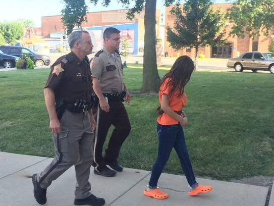 Alia Sierra, 17, of Frankfort, arrives to court Friday,