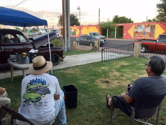 Guadalupe residents on Aug. 25, 2017, talk about their