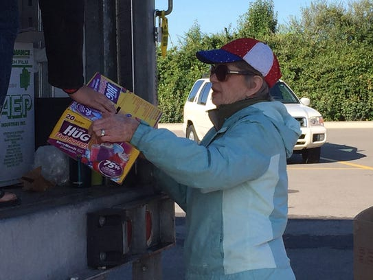 Natalie Stoelting helps load diapers at the East Thompson
