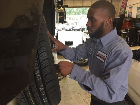 Javon Parker, an auto technician at Paul Campanella's