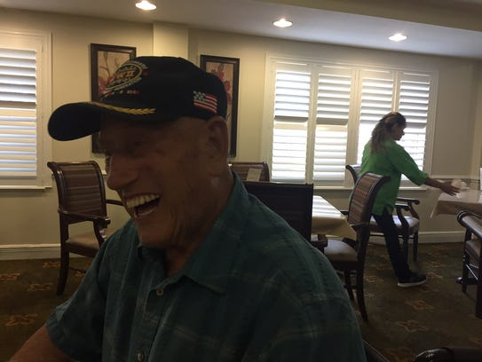 98-year-old Army medic Alex Barga shares a laugh with