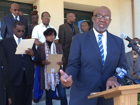 Rev. Lawrence Livingston speaks during a press conference