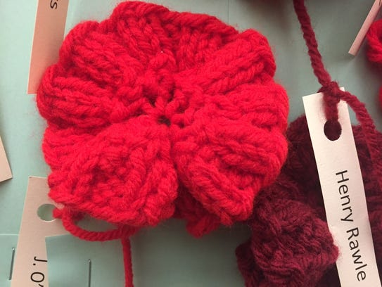 One of the almost 900 poppies Sharon Phillips knitted
