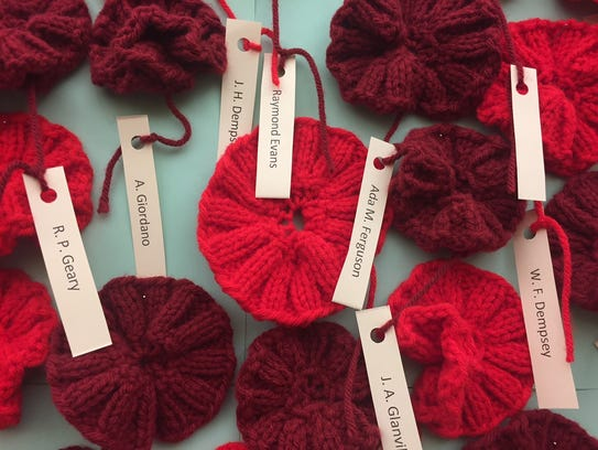 Poppies knitted by Sharon Phillips are adorned with