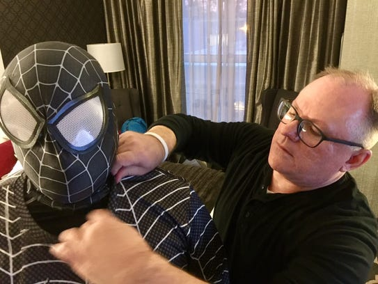 Wayne Dowdy helps Derrick Patterson put on his Spiderman