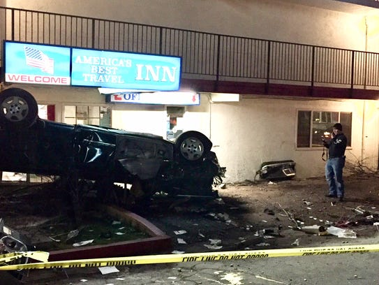 Reno police officers investigate a rollover crash that