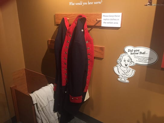 Visitors were invited to try on a Continental army soldier's jacket in the Discover History Center's interactive, hands-on display.