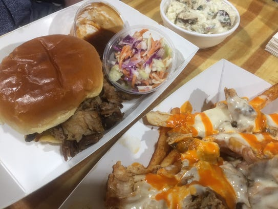 Pulled pork sandwich and Buffalo cheese fries from