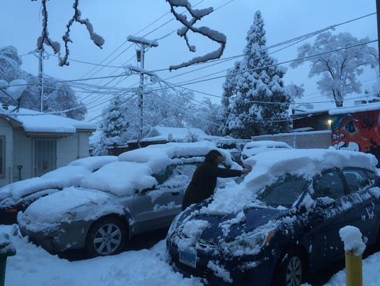 Snow in Northern Nevada closes schools and highways.