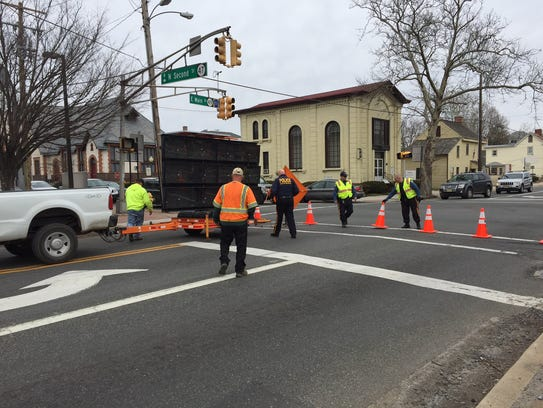 Millville city workers and police seal off a section