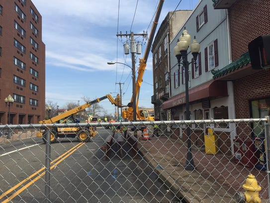 Two steel girders are in position outside Jim's Lunch in preparation for demolition of a building at 109 E. Main St. in Millville.