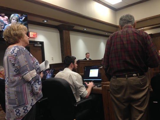 John Hirschi, right, speaks Tuesday, to the Wichita