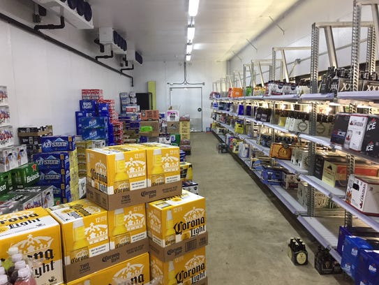 The commercially lit cooler at 7 Cuz Beer Store is