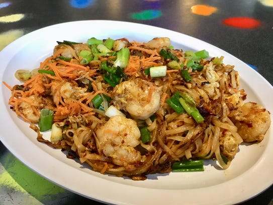 Grill Junkies serves up a few Asian entrees, including shrimp pad Thai.