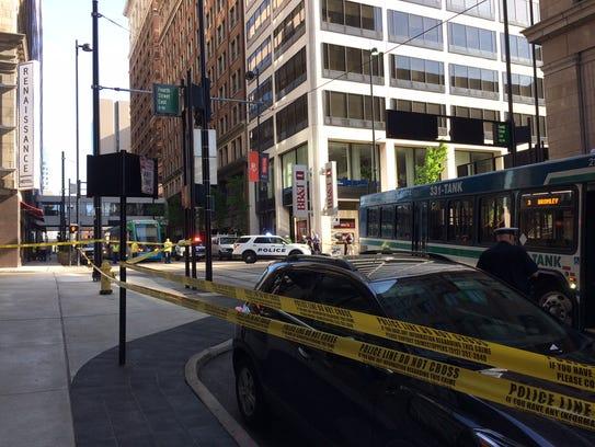 A bus struck a pedestrian near the corner of Fourth