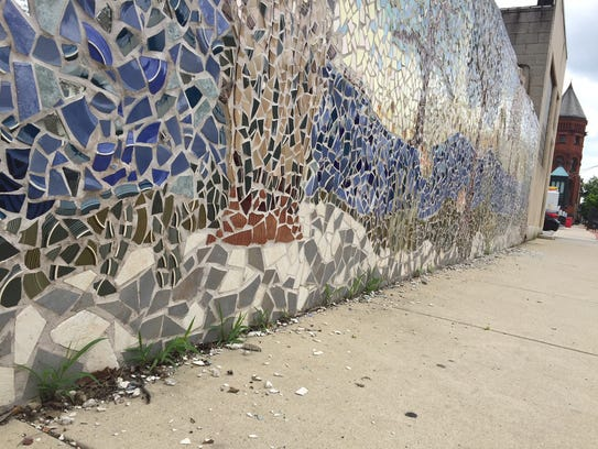 The 'Oasis' mosaic on the wall of a Met-Ed facility