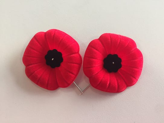 A pair of poppies from the Royal Canadian Legion, a