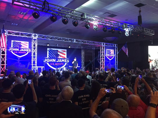 Kid Rock speaks at a rally for Senate candidate John