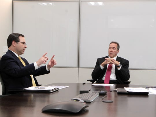 Carmichael (center) meets with Joseph Robinson (left), director of technology and operations, and Sid Deloatch, senior vice president and CIO,  during a meeting at Fifth Third's Downtown headquarters.