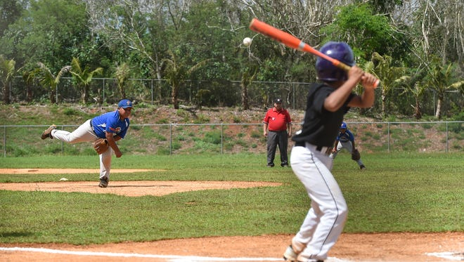 In this file photo, Yigo Thunder player Andrew Brown pitches against a Yigo Astros batter during their Guam PONY Baseball League game at Okkodo High School Field Complex in Dededo.