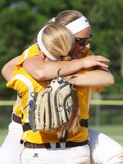 Watchung Hills' catcher Genna Cicchetti (8), left, and pitcher, Alyssa Murphy (22) celebrate the 6-2 win over Piscataway in the North 2 Group IV sectional final in Warren on June 2, 2016.