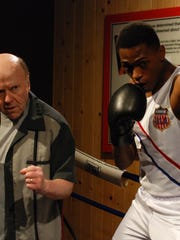"William McNulty and Justin Cornwell as boxing trainer Joe Martin and Cassius Clay Jr. at the Muhammad Ali Center. Both are in the world premiere of StageOne Family Theatre's ""And in This Corner ... Cassius Clay."""